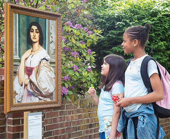 Two children look at a replica of a painting installed publicly in Philadelphia.