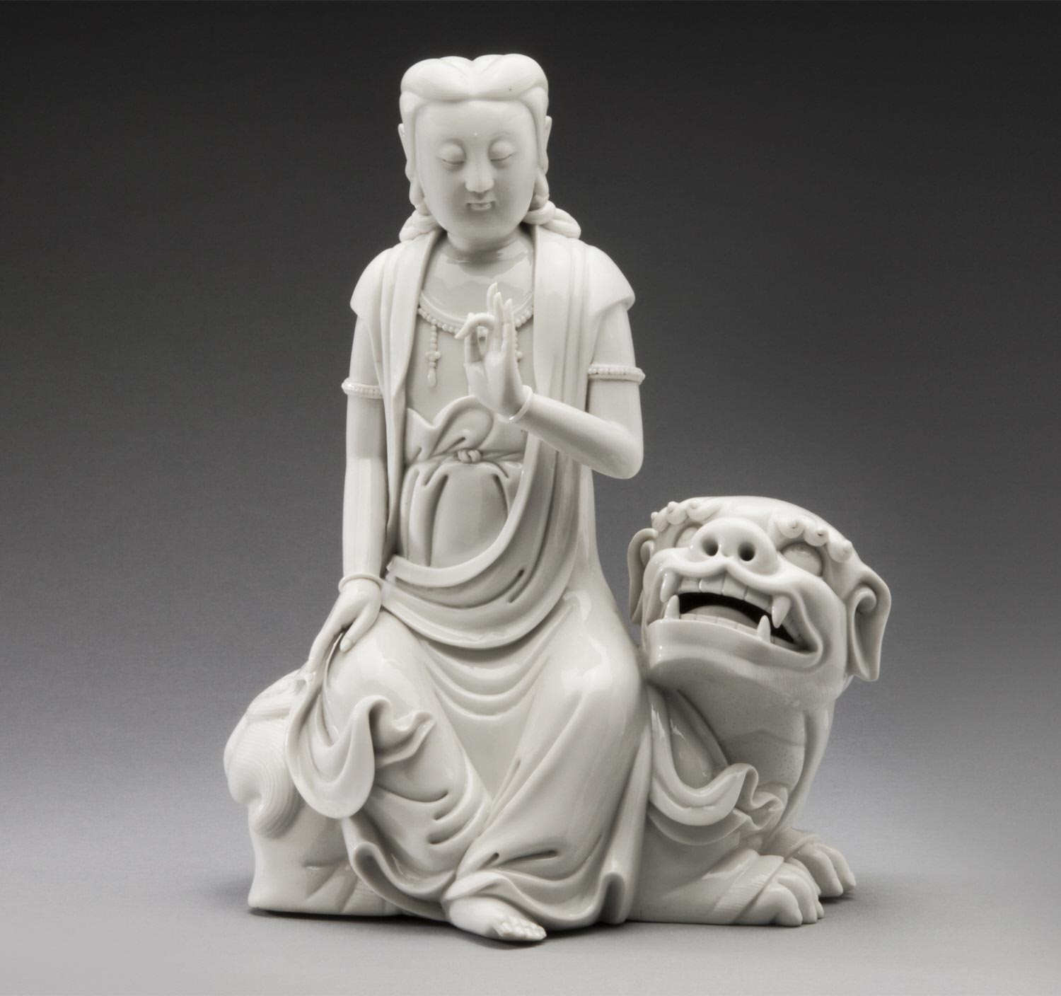 Guanyin Seated on Lion