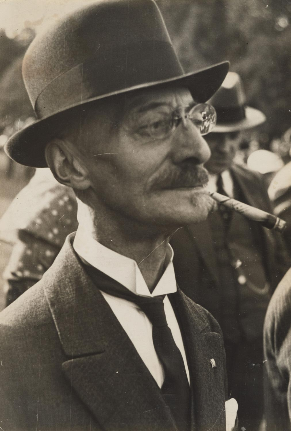 Man with Cigar at an Outdoor Event