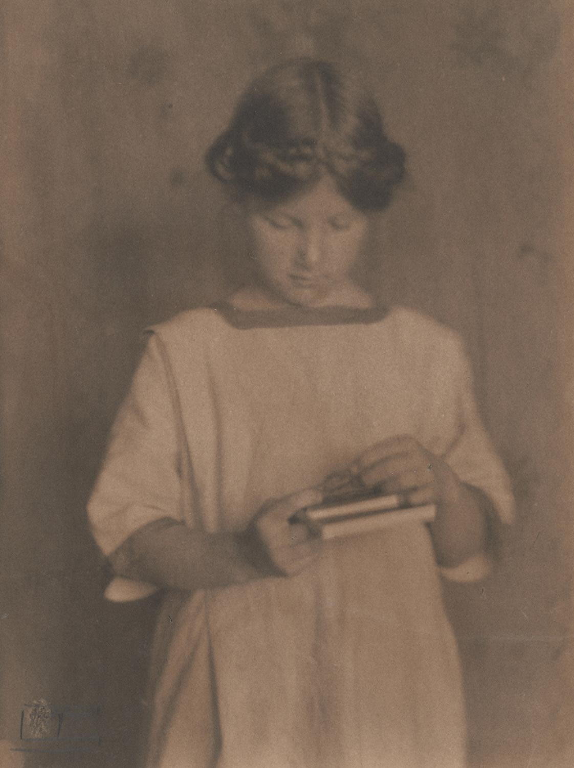 Portrait of a Girl Holding Books