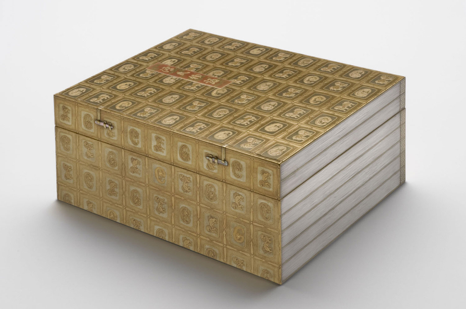 Accessory Box (Tebako) in the Form of a Bound Set of Tale of Genji Volumes