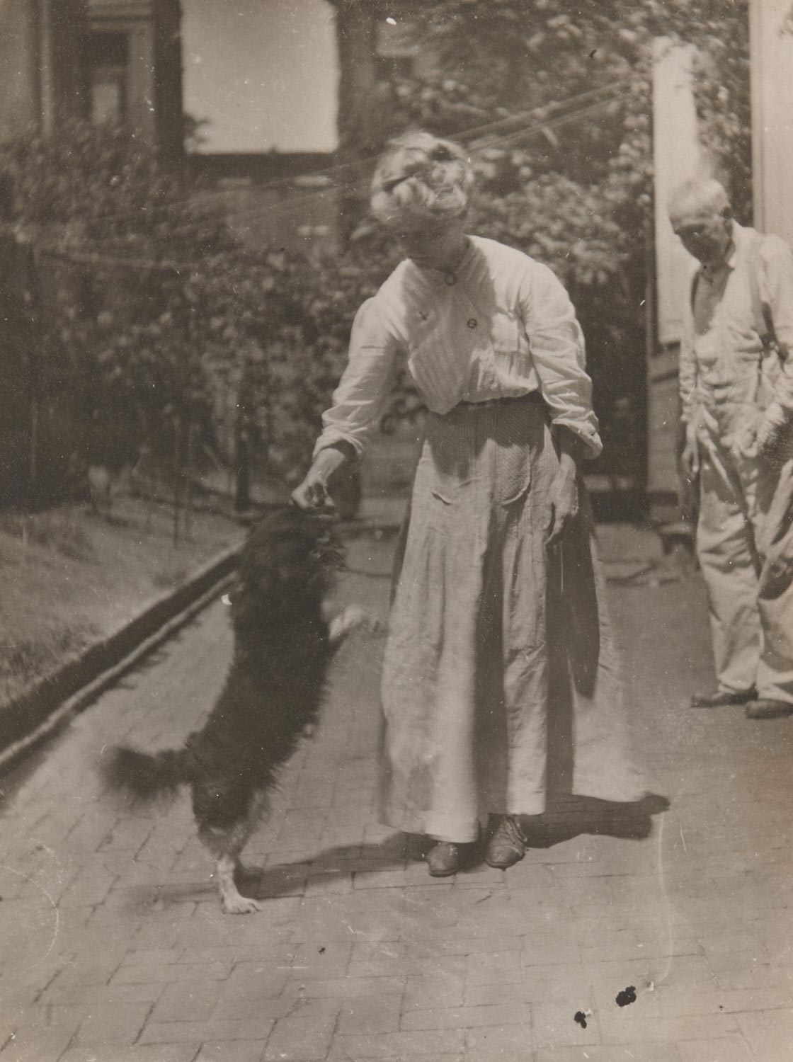 Thomas Eakins and Susan Macdowell Eakins with a Dog, in the Backyard, Mount Vernon Street
